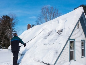 Raking Snow off a Roof photo by Christopher OKeefe